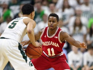 Feb 14, 2016; East Lansing, MI, USA; Indiana Hoosiers guard Yogi Ferrell (11) defends Michigan State Spartans guard Bryn Forbes (5) during the first half of a game at Jack Breslin Student Events Center. Mandatory Credit: Mike Carter-USA TODAY Sports